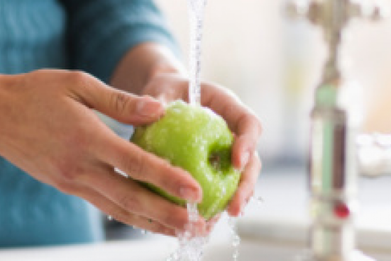 Photo: Woman washing a green apple